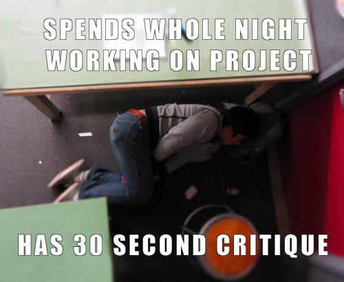 """Someone laying under a desk with the words """"spends who night working on project - has 30 second critique"""""""