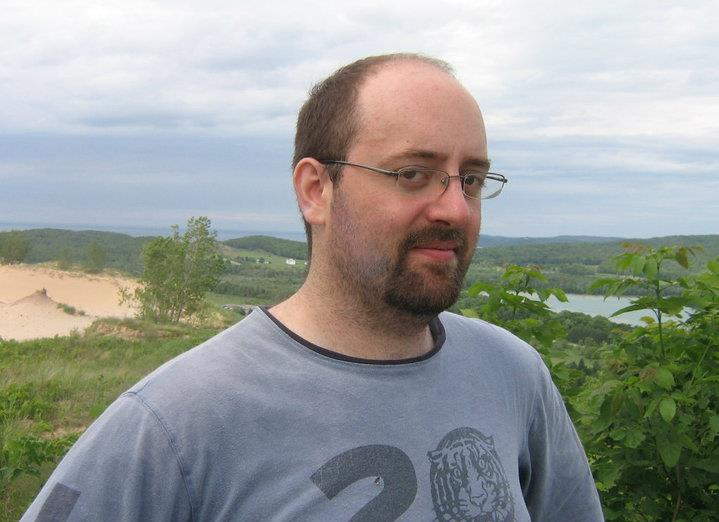 """A photo of me standing before a panoramic view of a green valley, published to: """"Poetry From the Working Class"""""""